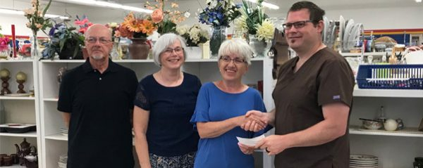 Morden Community Thrift Store presenting $3000 dollar cheque to Agassiz Medical Centre