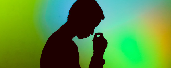 Silhouette of young man feeling stressed
