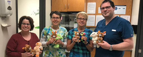 Agassiz Medical nurses holding stuffed animals